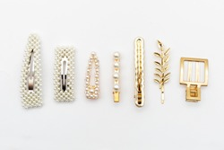 Pin set beauty trendy accessories hair pearl clip on white background. Top view. Copy space fot text.