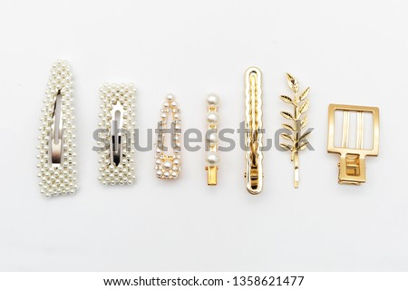 Pin set beauty trendy accessories hair pearl clip on white background. Top view. Copy space fot text.  Stockfoto ©