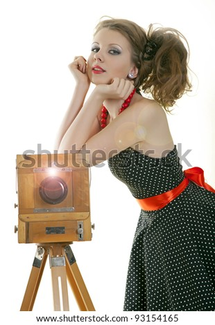 Pin-up girl and vintage camera