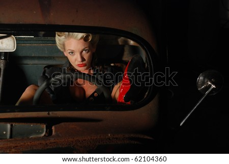 Pin Up Girl in a Classic Rat Rod Car