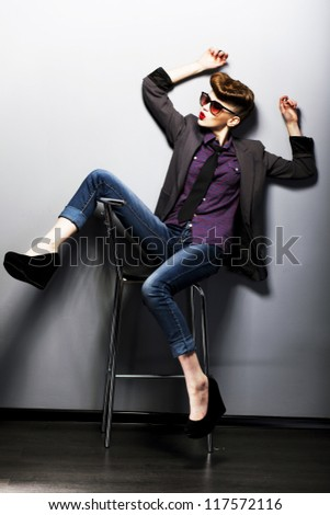 Pin-up girl in sunglasses sitting. American retro style. Hippie