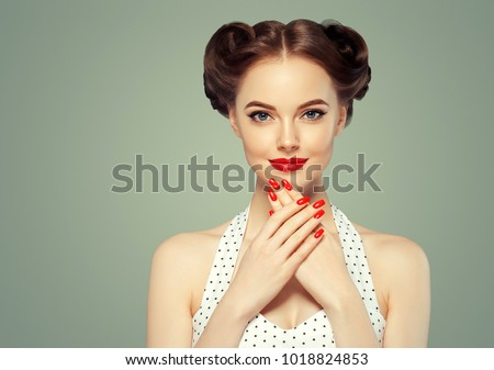 Pin up girl vintage. Beautiful woman pinup style portrait in retro dress and makeup, manicure nails hands, red lipstick and polka dot dress.