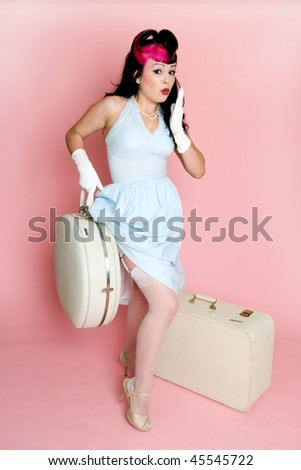 Pin up girl with vintage luggage.