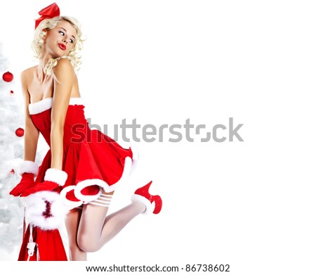 Pin-up sexy girl wearing santa claus clothes