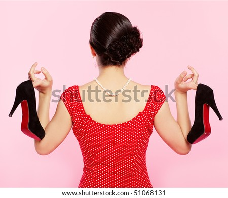 pin-up style portrait of brunette girl standing back to the observer