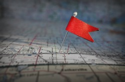 Pin with red flag stuck in a map