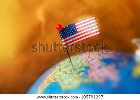 Pin with USA flag on a globe