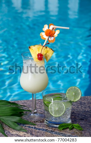 Pina Colada and Mojito cocktails on swimming pool side