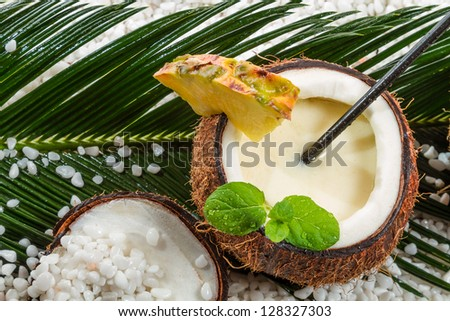 Pinacolada in a coconut on the beach
