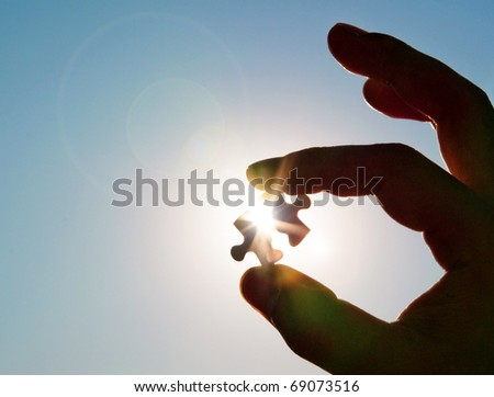 stock photo : Pinch a piece of the jigsaw puzzle