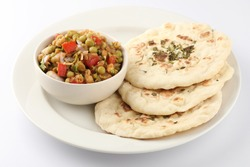 Pindi Chole Kulche or roadside choley Kulcha popular in India and pakistan is a popular streetfood. It's a spicy Chickpea or chana curry served with Indian Flat Bread