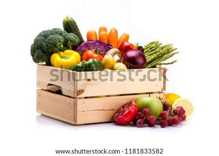 Pine box full of colorful fresh vegetables and fruits on a white background, ideal for a balanced diet, contains broccoli, cucumber, onion, asparagus, peppers, carrots, apple, grape, lima and potatoes #1181833582