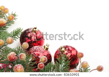 Pine branches, berries and balls with snow for Christmas border.