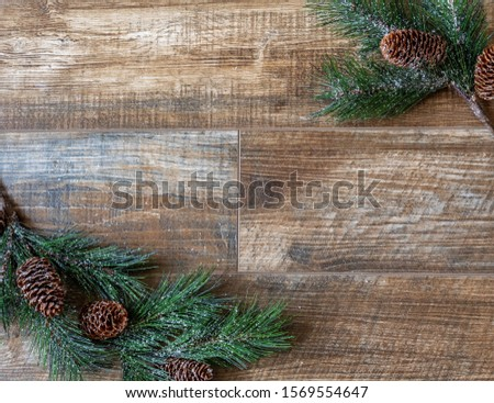 Pine branches with pine cones  on rustic wood background, for Christmas. Great for adverts, flyers,greeting cards, web design, etc. Can be used vertical or horizontal,flip left/right.