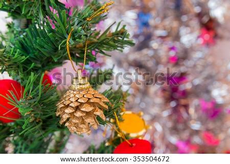 Pine cones and christmas decorations on christmas tree. Christmas concept. #353504672