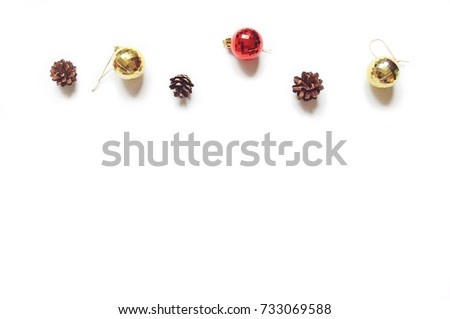 Pine cones, red and golden decorative balls. Christmas and New Year baubles on a white background. Mock-up, free space for text. Greeting card, banner, postcard. Minimalistic winter design. Flat lay #733069588