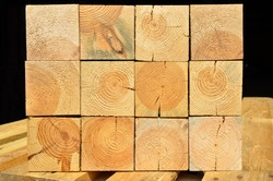 Pine lumber stacked in a row at the sawmill, lumber stack for storage construction or industrial work, sawn pine timber