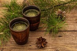 Pine needle tea, sollip-cha, traditional Korean beverage. Alternative medicine, healthy life style. Vintage wooden boards background