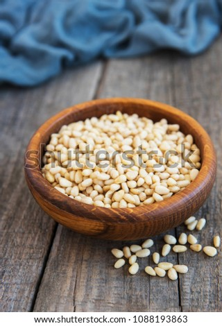 Pine nuts on a old wooden  table #1088193863