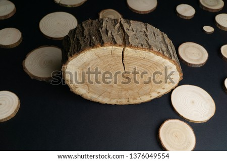 Pine tree cross-sections with annual rings on black background. Lumber piece close-up shot.