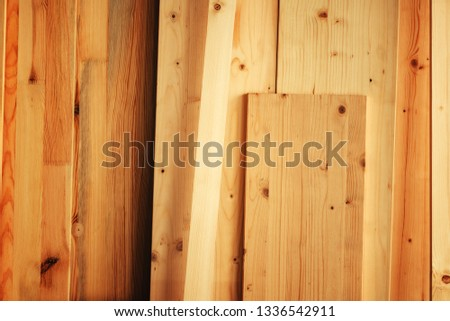 Pine wood floorboard planks in workshop ready to be used for hardwood flooring