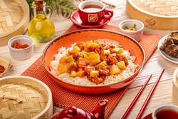 Pineapple and chicken in sweet and sour sauce. Traditional Chinese food