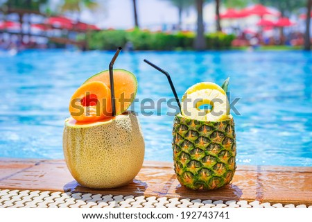 Pineapple and melon cocktails at the swimming pool