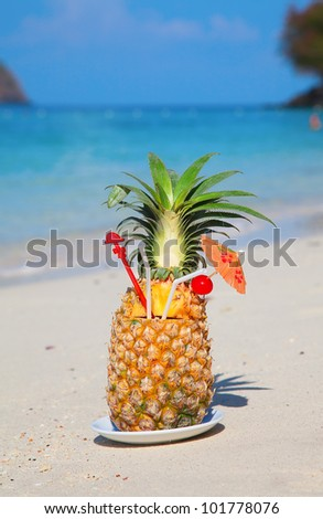 Pineapple cocktail on the white sandy beach