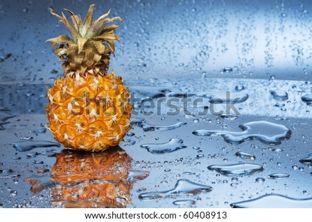 Pineapple fruit and droplets of water.