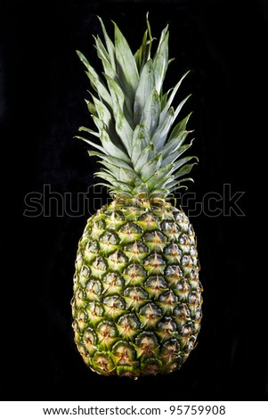 Pineapple fruit isolated on black background