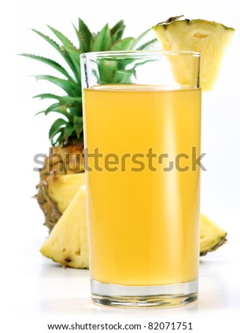 Pineapple juice in a glass of pineapple slices. Image on white background.