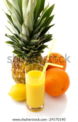 Pineapple, oranges, lemon and glass of juice on white background.