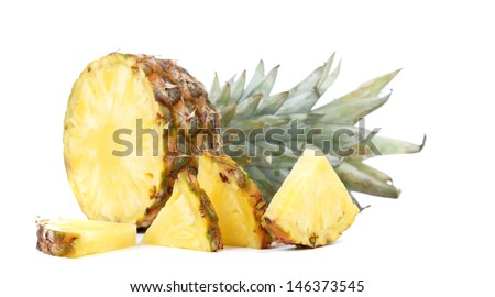 Pineapple with slices on a white background.