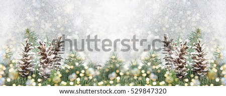 Pinecones and fir tree on sparkling background. Christmas decoration background #529847320