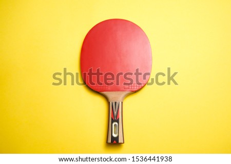 Pingpong bat or table tennis racket on yellow background Сток-фото ©