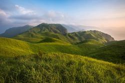 Pingxiang Wugong Mountain Scenery in Jiangxi Province, China. Lush green alpine grassland, alpine meadow sunset. Exotic Mountains of China, Wugong Shan National Park of China. Hiking Camping
