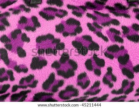 Pink and black faux fur leopard print backgound