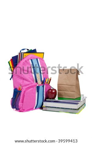 Pink and blue backpack with school supplies, textbooks, an apple and a sack lunch