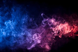 Pink and blue cloud of smoke of  black isolated background. Background from the smoke of vape