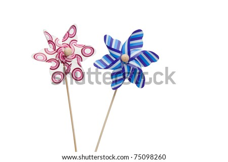 Pink and blue paper windmills on a white background
