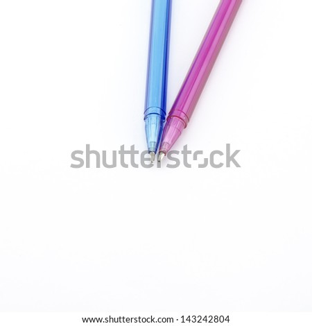 pink and blue pen isolated on white background