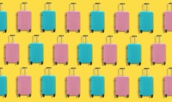 Pink and blue travel plastic suitcases pattern on yellow background. Bags on wheels for business trip, summer vacation, travel.