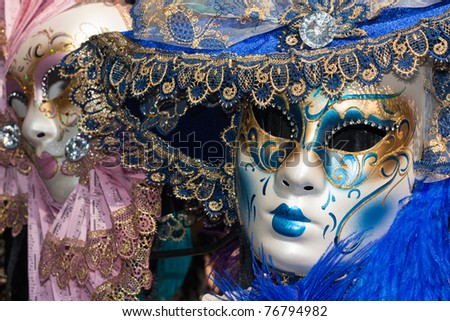 pink and blue venetian carnival masks