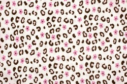 Pink and brown leopard pattern with flowers. Colorful magenta spotted animal print and floral print as background.