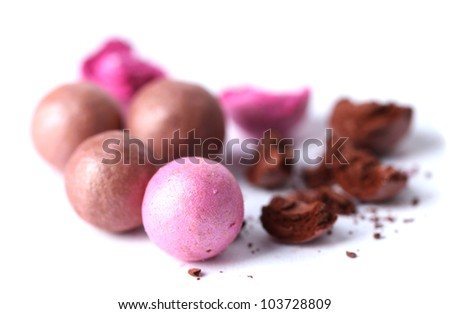 pink and brown powder balls isolated on white