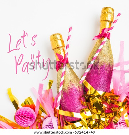Pink and Gold Mini bottles of champagne with golden confetti and tinsel. Flat lay. New year celebration or wedding concept theme #692414749