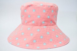 Pink and lightblue dot cotton hat with white background.