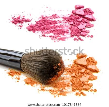 Pink and orange crushed powder and blush isolated on white background #1017841864