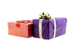 pink and purple giftbox with gold ribbon side view on isolated background