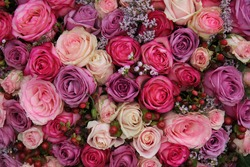 Pink and purple roses in a wedding flower arrangement